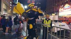 Bumblebee transformer robot impersonator talking cop Hollywood Boulevard night Stock Footage