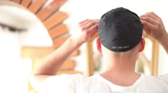 Man wears a black snapback Stock Footage