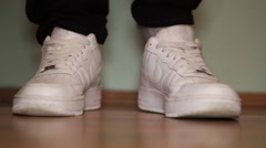 Wear white sneakers Stock Footage