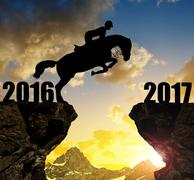 The rider on the horse jumping into the New Year 2017 - stock photo