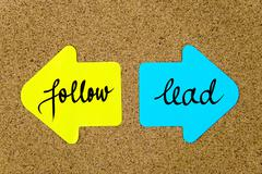 Message Follow versus Lead - stock photo