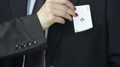 Businesswoman take ace, playing card from businessman pocket, closeup Stock Footage