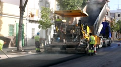 Workers Blacktopping a Street Stock Footage