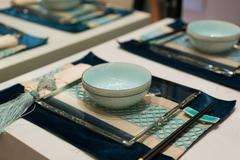 tableware on dining table - stock photo