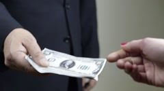 Businessman Take Bribe from a woman hand, hand to hand, closeup Stock Footage