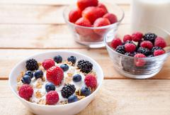 Healthy and nutritious yoghurt with cereal and fresh raw berries - stock photo