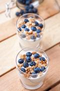 Nutritious and healthy yoghurt with blueberries and cereal Stock Photos