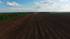 Two tractor seeded field. aerial survey. Against the background of a beautiful Stock Footage