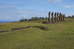 Row of seven ancient Moai statues facing the sea on Rapa Nui (Easter Island) Stock Photos
