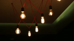 Many electrical lamps hanging from ceiling Stock Footage