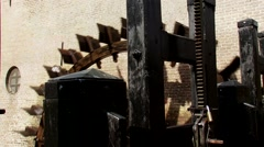 Water wheel in operation, powering an ancient gristmill Stock Footage