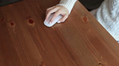 Female hand leads mouse on the table Stock Footage