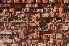 Destroyed by time and precipitation brick wall. - stock photo