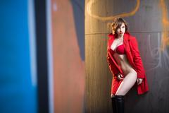 Attractive woman alluring in lingerie and coat. - stock photo