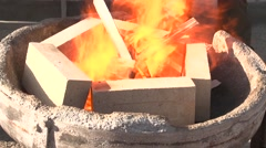 Lighting the fire in a forge - stock footage