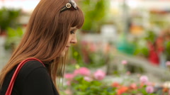 Buyer selects the potted flowers in the store Stock Footage