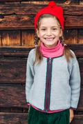 Summer holidays in the mountains a little girl in typical alpin costume. Stock Photos