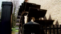 Vertically mounted water wheel in operation Stock Footage