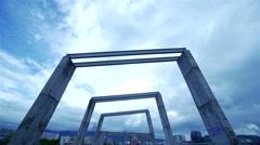 Rain clouds move concrete columns-timelapse Stock Footage