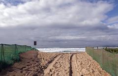 Green Shade Netting on Beach Access Area - stock photo