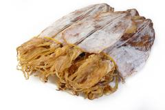 Dried squid on white background - stock photo