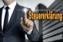 steuererklaerung (in german tax declaration) touchscreen is operated by busin - stock photo