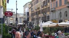 Shopping pedestrian street in Milan Italy - people tourists walking Stock Footage