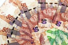 Closeup Circular Arrangement of South African Bank Notes - stock photo