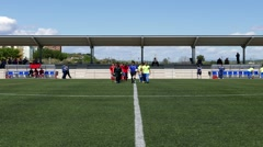 Soccer players at the start of a soccer match Stock Footage