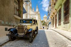 Classic car in a cobblestone street in Old Havana Stock Photos