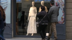 Mannequins in fashion clothes store front showcase shopping in Milan Stock Footage