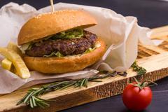gourmet homemade burger with garnish - stock photo