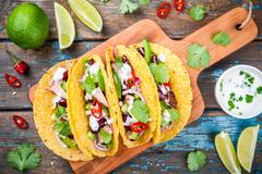 corn tacos with pork and vegetables - stock photo