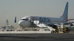 The jet of Flydubai airline on the platform - stock footage