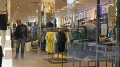 Interior of fashionable clothes store boutique shopping in Milan Italy Stock Footage