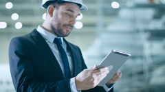 Businessman using Tablet in Aircraft Maintenance Terminal Stock Footage