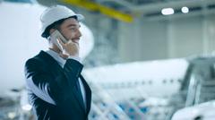 Businessman on the Phone Aircraft Maintenance Terminal Stock Footage