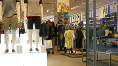 Interior of fashionable clothes store boutique shopping in Milan Italy - stock footage