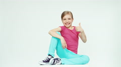 Girl 7-8 years laughing at camera on white background. Thumb up. Ok Stock Footage