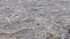 Raging stream of dirty water Stock Footage