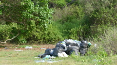 Garbage belt in the forest Stock Footage