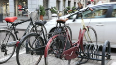 Retro bikes parking in cozy Milan street Stock Footage