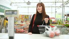 Girl in a garden centre makes shopping Stock Footage