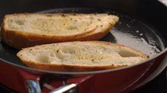 Fried bread on the pan Stock Footage