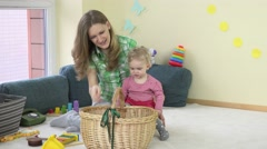 View of mother having fun with baby daughter at home. Stock Footage