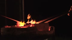 Preparing Melting pot in the night - stock footage