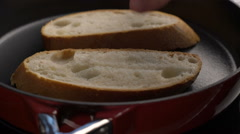 Toasted bread slices for making bruschettas Stock Footage