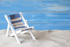 Summer Greeting Card With Deck Chair And Sand - stock photo