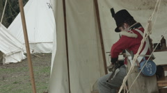Napoleon soldier reinactment  sewing Stock Footage