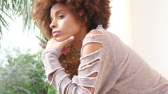 African American girl with afro hair waiting on balcony - sad and lonely Stock Footage